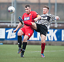 Shire's Iain Thomson clears from Queen's Park Tony Quinn.