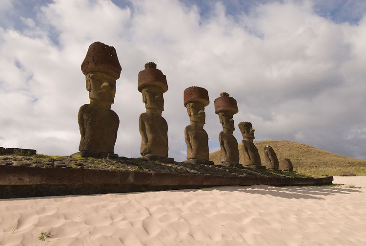 Chile, Easter Island: Anakena Beach, a white coral sand beach with palm trees and several restored moai or statues..Photo #: ch293-33858.Photo copyright Lee Foster www.fostertravel.com lee@fostertravel.com 510-549-2202