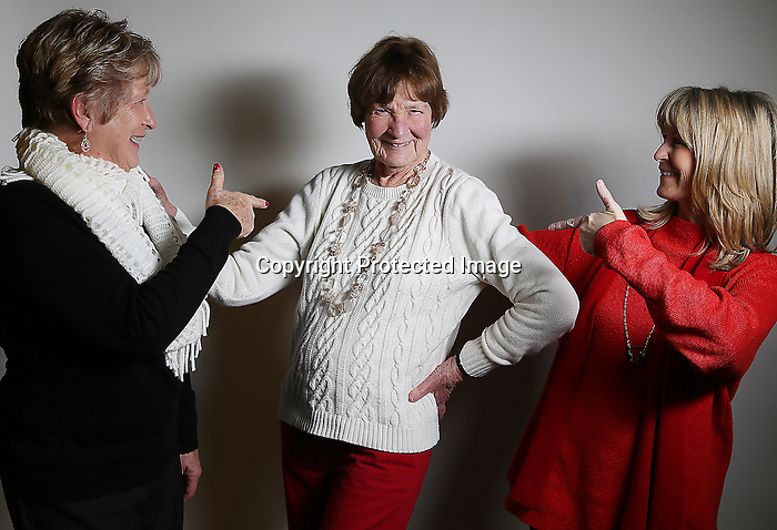 "Sharon Novick, left, and Terry Ball, right, react to Erin Ball striking a pose during a portrait session on New Years Eve at the Hynds Building. All three ladies listed their age as 'old' on our form however it's clear they are young in spirit. All three women also said friendship and the people are what makes Laramie County special to them.  To participate in WTE Photo Editor Michael Smith's 2014 ""Our Faces: Portraits of Laramie County"" project, call him at 633-3124 or 630-8388 or email msmith@wyomingnews.com. Michael Smith/staff"