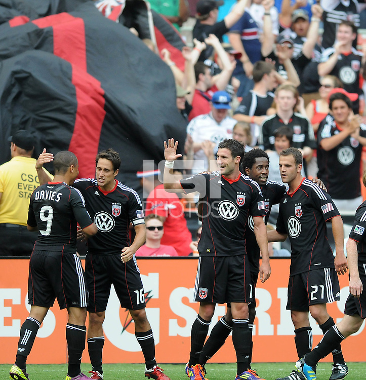 DC United midfielder Chris Pontius (13) celebrates his score with teammates.   Houston Dynamo tied DC United 2-2, at RFK Stadium, Saturday June 25, 2011.