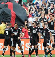 DC United midfielder Chris Pontius (13) celebrates his score with teammates.   Houston Dynamo tied DC United 2-2, at RFK Stadium, Saturday June 25, 2011.