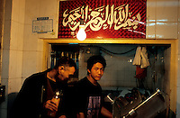 CHINA. Beijing. Men in a meat market in the Muslim district of 'Niu Jie'. 2005