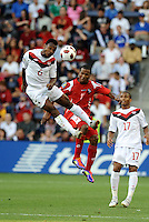 Julian De Guzman (6) midfielder Canada, wins the heder against Luis Henriquez Panama...Canada and Panama played to a 1-1 tie in Gold Cup play at LIVESTRONG Sporting Park. Kansas City Kansas.