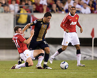 Corry Evans (31) of Manchester United fights for the ball with Kyle Nakazawa (13) of Philadelphia Union during a friendly match at Lincoln Financial Field in Philadelphia, Pennsylvania.  Manchester United defeated Philadelphia Union, 1-0.
