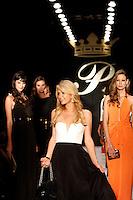 """BOGOTÁ -COLOMBIA. 24-04-2013. Paris Hilton visitó colombia para inaugurar en Bogotá """"Paris Hilton Purses"""" su tienda de accesorios y bolsos. el evento tuvo como atracción un desfile en donde modelos llevaron la colección que se venderá en lma tienda ubicada en Unicentro Bogotá./ Paris Hilton visited Colombia to launch her number 44 store """"Paris Hilton Purses""""  on Unicentro Bogota, dedicated to sell  handbags and accessories that were exhibited by a group of models in a   fashion show in Bogotá. Photo: VizzorImage / Str"""