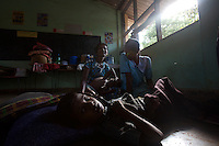"""A child, displaced by recent bombings in his town lays on a school's floor where she is hosted together with other 100 families in  Trincomalee, in Eastern Sri Lanka on Sunday October 08 2006..hundreds of families from Mutur had to abbandone their homes when caught in the cross fire between LTTE forces and government  forces in early August..The Sri Lanka civil was is an ongoing conf, The Sri Lanka civil was is an ongoing conflict on the island nation of Sri Lanka Since the 1983 """"Black July""""  pogrom there has been on and off civil war, mostly between the government and the Liberation Tigers of Tamil Eelam, or the LTTE, who want to create an independent state of Tamil Eelam in the north east of the island. It is estimated that the war has left 65000 people dead since 1983 and caused great harm to the population and economy of the country. A cease fire was declared in 2001, but hostilities renewed in late 2005. Following escalation of violence         in July 2006, a senior rebel leader declared the ceasefire null and void, although both sides later reaffirmed their commitment to the ceasefire agreement. Hundreds of people, including military personnel, rebels, and Tamil, Sinhalese and muslim civilians have been killed in fighting this year. Thousands of civilians have been displaced, many coming from areas already stroke by the dec 2004 Tsunami.."""