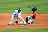 Chattanooga Lookouts second baseman Rafael Ynoa #5 takes a throw as Keenyn Walker #21 steals second during a game against the Birmingham Barons on April 17, 2013 at AT&T Field in Chattanooga, Tennessee.  Chattanooga defeated Birmingham 5-4.  (Mike Janes/Four Seam Images)
