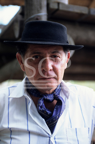 Buenos Aires, Argentina.  Gaucho man in hat and wearing a scarf.