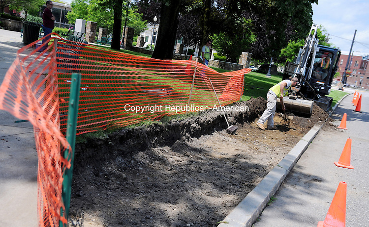 TORRINGTON, CT, 03 JUNE 13- 060313AJ01-  Kevin Mathews and Chris Moser, of Torrington-based Greenstone Landscaping and Stonework dig a trench for new sidewalks at Coe Memorial Park in Torrington Monday afternoon. Walt Combes, a city inspector, said the crew is installing new sidewalks along the South Main Street edge of the street where there now are no sidewalks. The sidewalks are a portion of an ongoing $424,300 phase II restoration of the park. This phase includes installing a new parking lot and upgrades to irrigation and electrical systems.  ALEC JOHNSON/ REPUBLICAN-AMERICAN