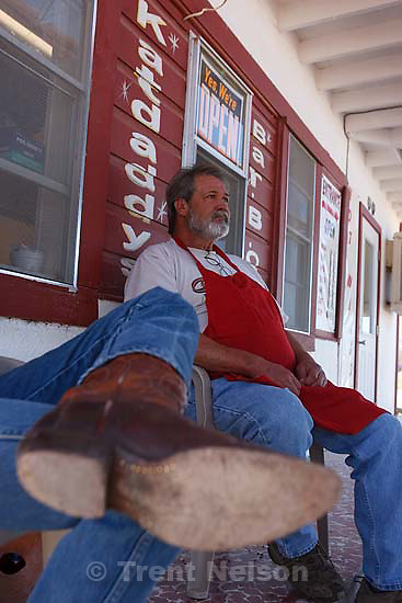 "Eldorado - ""Jimmy"" (left) and ""Katdaddy"" take in the afternoon out in front of Katdaddy's Bar-B-Que Saturday, April 5, 2008. Katdaddy says he's glad that Texas Child Protective Services has removed children from the FLDS YFZ ""Yearning for Zion"" compound just outside of town, after allegations of child abuse."