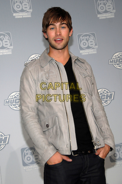 CHACE CRAWFORD .The 19th Annual MuchMusic Video Awards at the Chum City Building, Toronto, Ontario, Canada..June 15th, 2008.half length grey gray leather jacket stubble facial hair black top hands in pockets mouth open.CAP/ADM/BPC.©Brent Perniac/AdMedia/Capital Pictures.