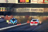 Nov 8, 2013; Pomona, CA, USA; NHRA funny car driver Jeff Diehl (left) races alongside Grant Downing during qualifying for the Auto Club Finals at Auto Club Raceway at Pomona. Mandatory Credit: Mark J. Rebilas-