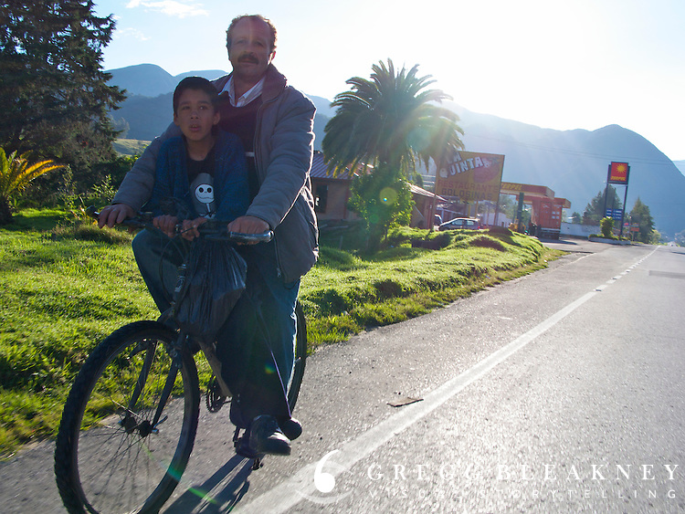 Father pedals his son to school - Colombia