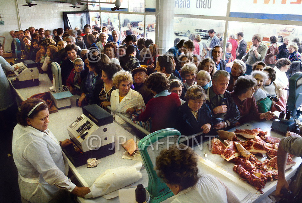 Poland, September, 1981 - People shopping at a butcher in the Warsaw suburbs. Because most of what is grown in Poland is distributed elsewhere in the USSR, shoppers endure long lines and shortages of nearly everything.