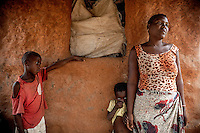 Witchdoctor Jelinha Damota (30) with her son Damota (8) daughter Laurinha (4). Jelinha is the mother of five children.