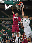 Troy Trojans guard Alan Jones (11) and North Texas Mean Green forward Tony Mitchell (13) in action during the game between the Troy Trojans and the University of North Texas Mean Green at the North Texas Coliseum,the Super Pit, in Denton, Texas. UNT defeats Troy 87 to 65.....