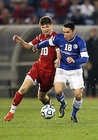 HOOVER, AL - DECEMBER 07, 2012:  Dylan Lax (30) of the University of Indiana tackles Timo Pitter (18) of Creighton University during an NCAA 2012 Men's College Cup semi-final match, at Regions Park, in Hoover , AL, on Friday, December 07, 2012. Indiana won 1-0.