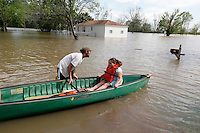 Joshua Robertson pushes Loveta Miller, 7, of Benton, out for a canoe ride in the yard of Bill Sandquist in the Red Star District of Cape Girardeau, MO, on Thursday, April 28, 2011.