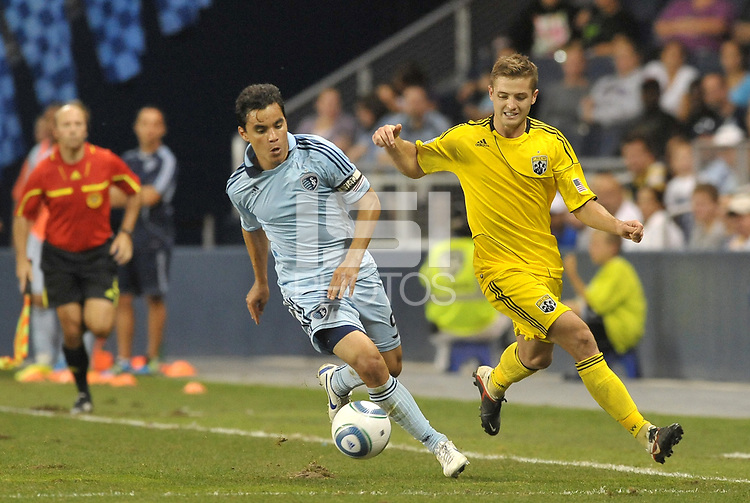 Omar Bravo (99) Sporting KC fights for the ball with Robbie Rogers Columbus Crew... Sporting Kansas City defeated Columbus Crew 2-1 at LIVESTRONG Sporting Park, Kansas City, Kansas.