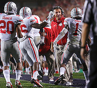 Ohio State Buckeyes head coach Urban Meyer reacts to Ohio State Buckeyes cornerback Bradley Roby (1) after the blocked punt and touchdown during the first half of the NCAA football game between Ohio State and Northwestern at Ryan Field in Evanston, Illinois on Saturday, October 5, 2013. Final score: Ohio State 40, Northwestern 30. (Columbus Dispatch photo by Jonathan Quilter)