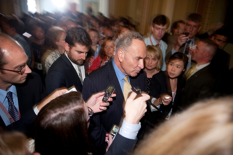 UNITED STATES - AUGUST 2: Sen. Charles Schumer, D-N.Y., wades through a throng of reporters following his news conference on the Senate vote to raise the debt limit ceiling on Tuesday, Aug. 2, 2011. (Photo By Bill Clark/Roll Call)