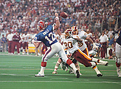 Washington Redskins safety Alvoid Mays (20) knocks the ball from Buffalo Bills quarterback Jim Kelly (12) during Super Bowl XXVI in Minneapolis, Minnesota on January 26, 1992.  The Redskins won the game and the World Championship 37 - 24.<br /> Credit: Howard L. Sachs / CNP