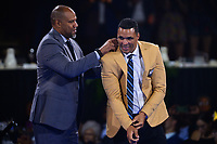 Canton, Ohio - August 2, 2019:  Tony Gonzalez receives his Hall of Fame Gold Jacket from his friend Dennis Allen at the Canton Civic Center in Canton, Ohio August 2, 2019.  (Photo by Don Baxter/Media Images International)