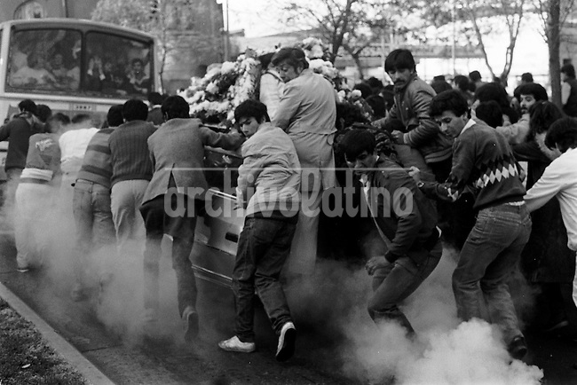 Funeral del estudiante  Ronald Wood asesinado el 20 de mayo de l986 en una Jornada por la Democracia, por la tarde Wood junto a un grupo de estudiantes particip&radic;&ge; en manifestaciones. Militares que controlaban la manifestaci&radic;&ge;n dispararon hiriendo mortalmente a Ronald Wood.<br /> Santiago Chile 25 mayo 1986<br /> <br /> Forty years ago, on September 11, 1973, a military coup led by General Augusto Pinochet toppled the democratic socialist government of Chile. President Salvador Allende was killed during the  attack to seize  La Moneda presidential palace.  In the aftermath of the coup, a quarter of a million people were detained for their political beliefs, 3000 were killed or disappeared and many thousands were tortured.<br /> Some years later in 1981, while Pinochet ruled Chile with iron fist, a young photographer called Juan Carlos Caceres started to freelance in the streets of Santiago and the poblaciones or poor outskirts, showing the growing resistance against the dictatorship. For the next 10 years Caceres photographed every single protest and social movement fighting for the restoration of democracy. He knew that his camera was his only weapon, he knew that his fate was to register the daily violence and leave his images for the History.<br /> In this days Caceres is working to rescue and organize his collection of images in the project Imagenes de la Resistencia   . With support of some Chilean official institutions, thousands of negatives are digitalized and organized to set up the more complete visual heritage of this  violent period of Chile&acute;s history.