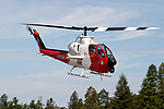 "A United States Forest Service 'Firewatch' Helicopter approaches the Grass Valley Air Attack Base in California's Sierra Nevada mountains. The USFS ""Firewatch"" helicopter is based on a demilitirized Army Cobra gunship with the chin gun removed and replaced with a forward looking infrared thermal imaging system that allows the crew to send images to the command center to show where a forest fire's hot spots are. In addition the thermal imaging system the aircraft is also equipped with a Traffic Collision and Avoidance System for identifying other aircraft in the vicinity, an onboard computer, geo-locating capabilities to aid in low visibility and microwave for sending live infrared videos back to fire camp at a distance of up to 30 miles. Photographed 07/05"