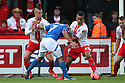 Andy Barcham of Portsmouth is stopped by Jimmy Smith (l) and Bruno Andrade of Stevenage (on loan from QPR)<br />  - Stevenage v Portsmouth - FA Cup 1st Round  - Lamex Stadium, Stevenage - 9th November, 2013<br />  © Kevin Coleman 2013