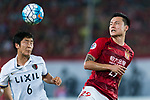 Guangzhou Forward Gao Lin (R) fights for the ball with Kashima Midfielder Ryota Nagaki (L) during the AFC Champions League 2017 Round of 16 match between Guangzhou Evergrande FC (CHN) vs Kashima Antlers (JPN) at the Tianhe Stadium on 23 May 2017 in Guangzhou, China. (Photo by Power Sport Images/Getty Images)