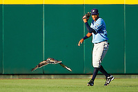 A hawk joins Yem Prades (19) of the Northwest Arkansas Naturals in center field during a game against the Springfield Cardinals at Hammons Field on June 14, 2012 in Springfield, Missouri. (David Welker/Four Seam Images).