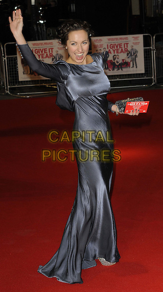 Kerry Howard.attending the 'I Give It A Year' European film premiere, Vue West End cinema, Leicester Square, London, England, UK, 24th January 2013..full length grey gray dress side long sleeve silk satin maxi clutch bag smiling hand arm raised up waving mouth open funny .CAP/CAN.©Can Nguyen/Capital Pictures.