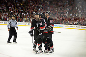 March 09, 2009. Raleigh, NC.. The Carolina Hurricanes beat the New York Rangers 3-0 at the RBC Center in Raleigh.. Teammates congratulate #15 Tuomo Ruutu on the team's third goal of the night.