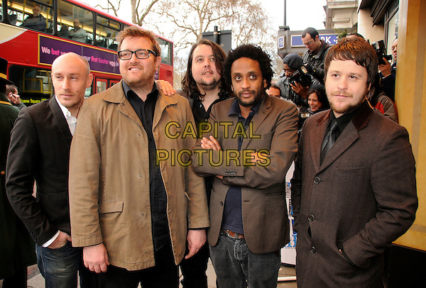ELBOW.Attending The South Bank Show Awards, The Dorchester Hotel, London, England, January 20th 2009..half length brown suit jacket grey gray .CAP/CAS.©Bob Cass/Capital Pictures