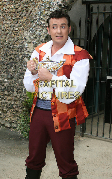 SHANE RICHIE .Photocall at Hell Fire Caves West Wycombe to launch the 'Aladdin' Pantomime to be held Swan Theatre, High Wycombe, England..September 14th 2009.half 3/4 length white shirt orange vest waistcoat costume lamp genie trousers .CAP/JIL.©Jill Mayhew/Capital Pictures