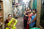 "Faridpur Brothel is the second to largest brothel in Bangladesh. (17 registered brothels in the country) 600+ girls live in a hidden neighboorhood accesible through one of the six alleyways, covered with small ragged curtains mimicking doors. Many girls are under aged - the ""legal"" age being 18. Joshna (Madame on the left) is excpetional - she treats her girls like daughters, watches over them and lets them grow and mature untill they have the self-power and the money to leave ""this hell hole"". March 13, 2011. Gabriela Barnuevo"