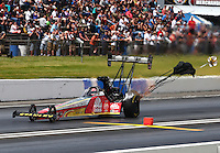 May 31, 2014; Englishtown, NJ, USA; NHRA top fuel driver Doug Kalitta deploys his parachutes after taking the top qualifying position during qualifying for the Summernationals at Raceway Park. Mandatory Credit: Mark J. Rebilas-