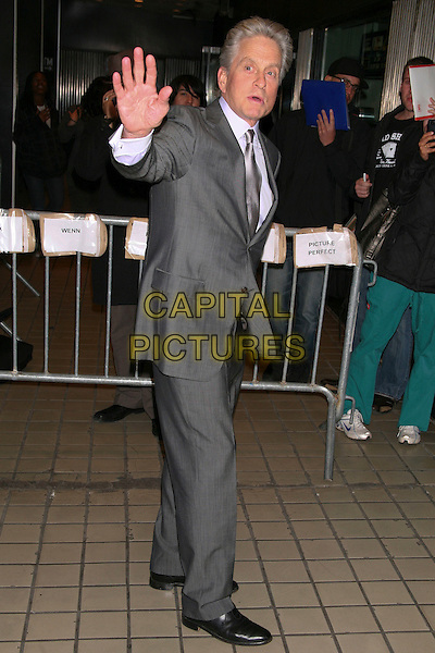 "MICHAEL DOUGLAS.The Premiere of ""Solitary Man"" at Cinema 2, New York, NY, USA..May 11th, 2010.full length hand palm waving grey gray suit side .CAP/LNC/TOM.©TOM/LNC/Capital Pictures."