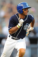 Asheville Tourists second baseman Russell Wilson #3 runs to first during a game against the Rome Braves at McCormick Field on June 23, 2011 in Asheville, North Carolina.  The Tourists won the game 10-4.  (Tony Farlow/Four Seam Images)