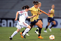 Action photo of Carli Lloyd of USA fighting for the ball with Diana Matheson of Canada, during game of the Womens Preolympic soccer tournament held at Ciudad Juarez.