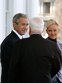 Washington, D.C. - March 5, 2008 -- United States President George W. Bush (L) welcomes Cindy McCain (R) and Republican presidential nominee Sen. John McCain (R-AZ) (back to camera) to the White House March 5, 2008 in Washington, DC. Bush will announce his endorsement of McCain for the GOP nomination in the Rose Garden after a private lunch. McCain reached the required 1,191 delegates necessary to clinch the nomination after Tuesday primaries in Ohio, Texas, Vermont and Rhode Island put him over the top.  .Credit: Chip Somodevilla - Pool via CNP