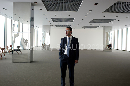 Istanbul, Turkey<br /> March 9, 2011<br /> <br /> Nahit Kile (center), the Kiler Holding Chairman and owner of the Sapphire building, a skyscraper, (the tallest building in Europe) on the sky terrace that overlooks all of Istanbul and is open to the public. The building is located in Istanbul's Levent business district. It is a luxury shopping and residence mixed-use project by Biskon Construction (a subsidiary of the Kiler group of companies). Sapphire Istanbul offers a luxurious life style to owners as upper floor apartments sell for as high as $7,500,000 US.