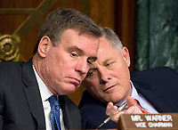 """United States Senators Richard Burr (Republican of North Carolina), Chairman, right, and Mark Warner (Democrat of Virginia) Vice Chairman, left, US Senate Select Committee on Intelligence discuss the testimony as the committee conducts an open hearing titled """"Disinformation: A Primer in Russian Active Measures and Influence Campaigns"""" on Capitol Hill in Washington, DC on Thursday, March 30, 2017. Photo Credit: Ron Sachs/CNP/AdMedia"""