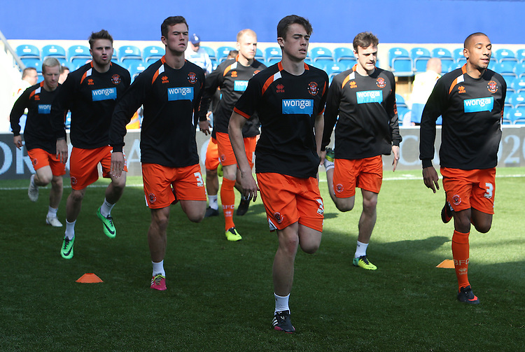 Blackpool's players during the pre-match warm-up <br /> Photo by Kieran Galvin/CameraSport<br /> <br /> Football - The Football League Sky Bet Championship - Queens Park Rangers v Blackpool - Saturday 29th March 2014 - Loftus Road - London<br /> <br /> &copy; CameraSport - 43 Linden Ave. Countesthorpe. Leicester. England. LE8 5PG - Tel: +44 (0) 116 277 4147 - admin@camerasport.com - www.camerasport.com