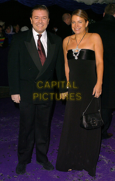 RICKY GERVAIS & WIFE.British Comedy Awards 2005 Arrivals, London..UK, United Kingdom..14th December 2005.Ref: CAN.full length with together married husband wife black suit halterneck dress holding hands.www.capitalpictures.com.sales@capitalpictures.com.©Capital Pictures