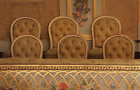 "Detail of gilded moulding and floral painting of the guard-rail of the first balcony with public chairs in the background, Theatre Imperial Napoleon III de Fontainebleau (Fontainebleau Theatre Napoleon III), 1853-1856, by Hector Lefuel, Fontainebleau, Seine-et-Marne, France. Restoration of the theatre began in Spring 2013 thanks to an agreement between the Emirate of Abu Dhabi and the French Governement dedicating 5 M€ to the restoration.  In recognition of the sponsorship by the Emirate of Abu Dhabi, French Governement decided to rename the theatre as ""Theatre Cheikh Khalifa bin Zayed Al Nahyan"" (Cheikh Khalifa bin Zayed Al Nahyan Theatre). The achievement of the first stage of renovation has allowed the opening of the theatre to the public on May 3, 2014. Picture by Manuel Cohen"