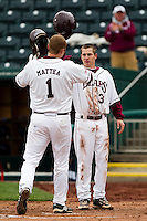 Travis McComack (31) of the Missouri State Bears congratulates Derek Mattea (1) at home plate after hitting a homerun during a game against the Oral Roberts Golden Eagles on March 27, 2011 at Hammons Field in Springfield, Missouri.  Photo By David Welker/Four Seam Images