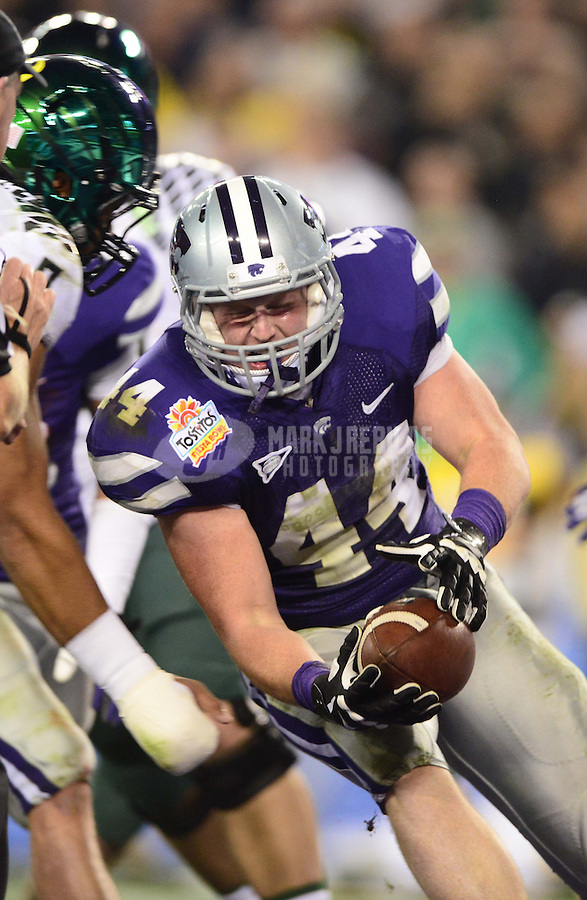 Jan. 3, 2013; Glendale, AZ, USA: Kansas State Wildcats defensive end Ryan Mueller (44) recovers a blocked field goal against the Oregon Ducks during the 2013 Fiesta Bowl at University of Phoenix Stadium. Oregon defeated Kansas State 35-17. Mandatory Credit: Mark J. Rebilas-