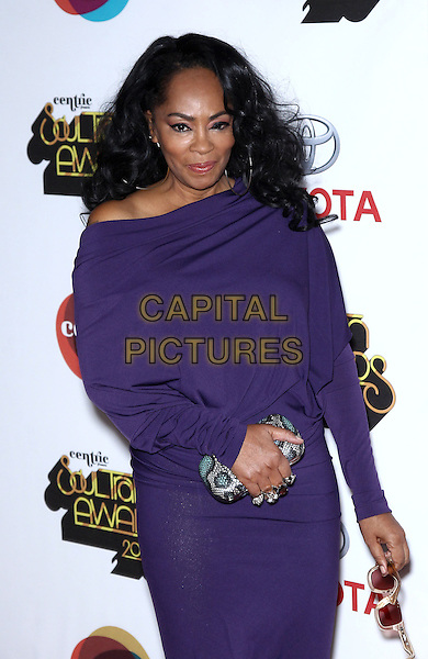 Jodie Watley.2012 Soul Train Awards red carpet at the fabulous Planet Hollywood Resort and Casino, Las Vegas, Nevada, USA, .8th November 2012..half length purple dress off the shoulder long sleeve clutch bag .CAP/ADM/MJT.© MJT/AdMedia/Capital Pictures.